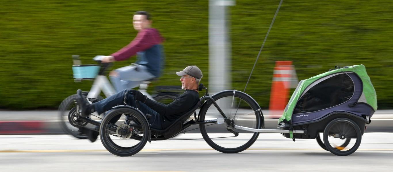 a person riding a bike down a street