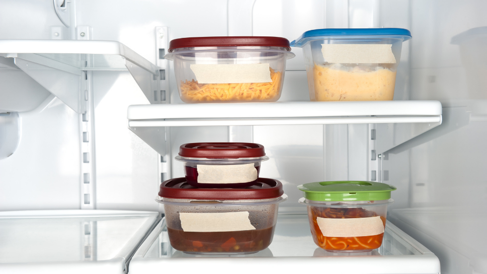 an open refrigerator filled with food in Tupperware boxes