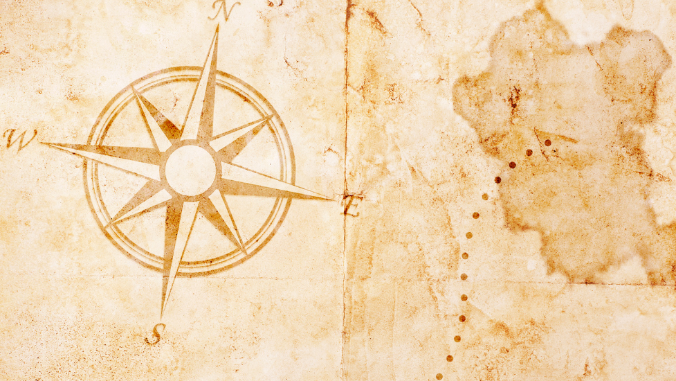 a close up of an old map with a compass on it