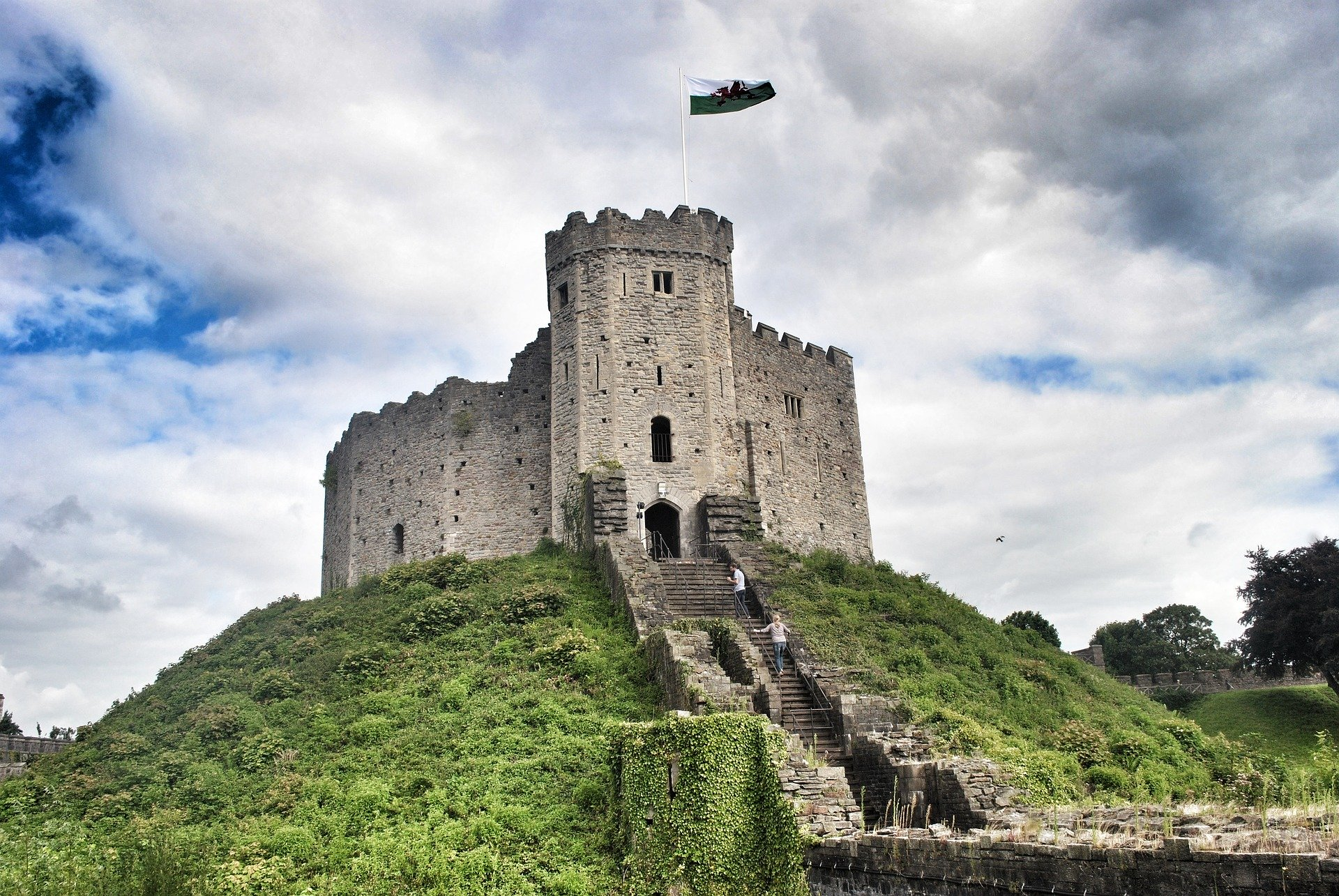 a castle on a hill with Cardiff Castle in the background