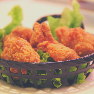 chicken strips on a bed of lettuce