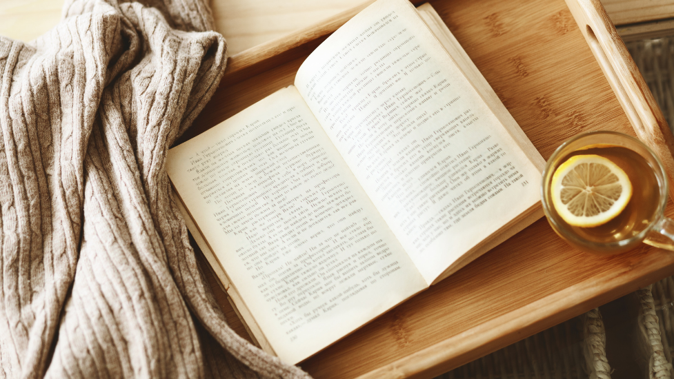 a book on a wooden board