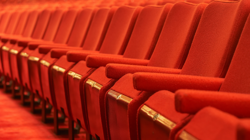 a row of red theatre chairs