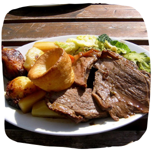 a plate with a roast dinner on a table