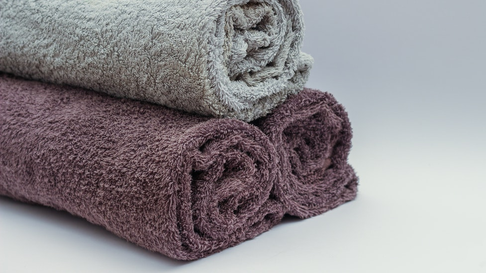 three towels rolled up