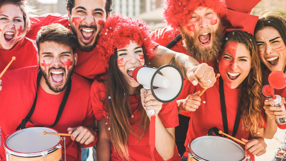 a group of people dressed in red posing for the camera