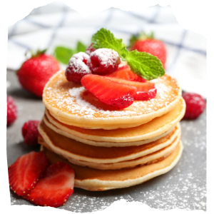 pancakes with strawberries on the top