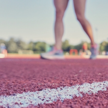 a close up of person on a running track