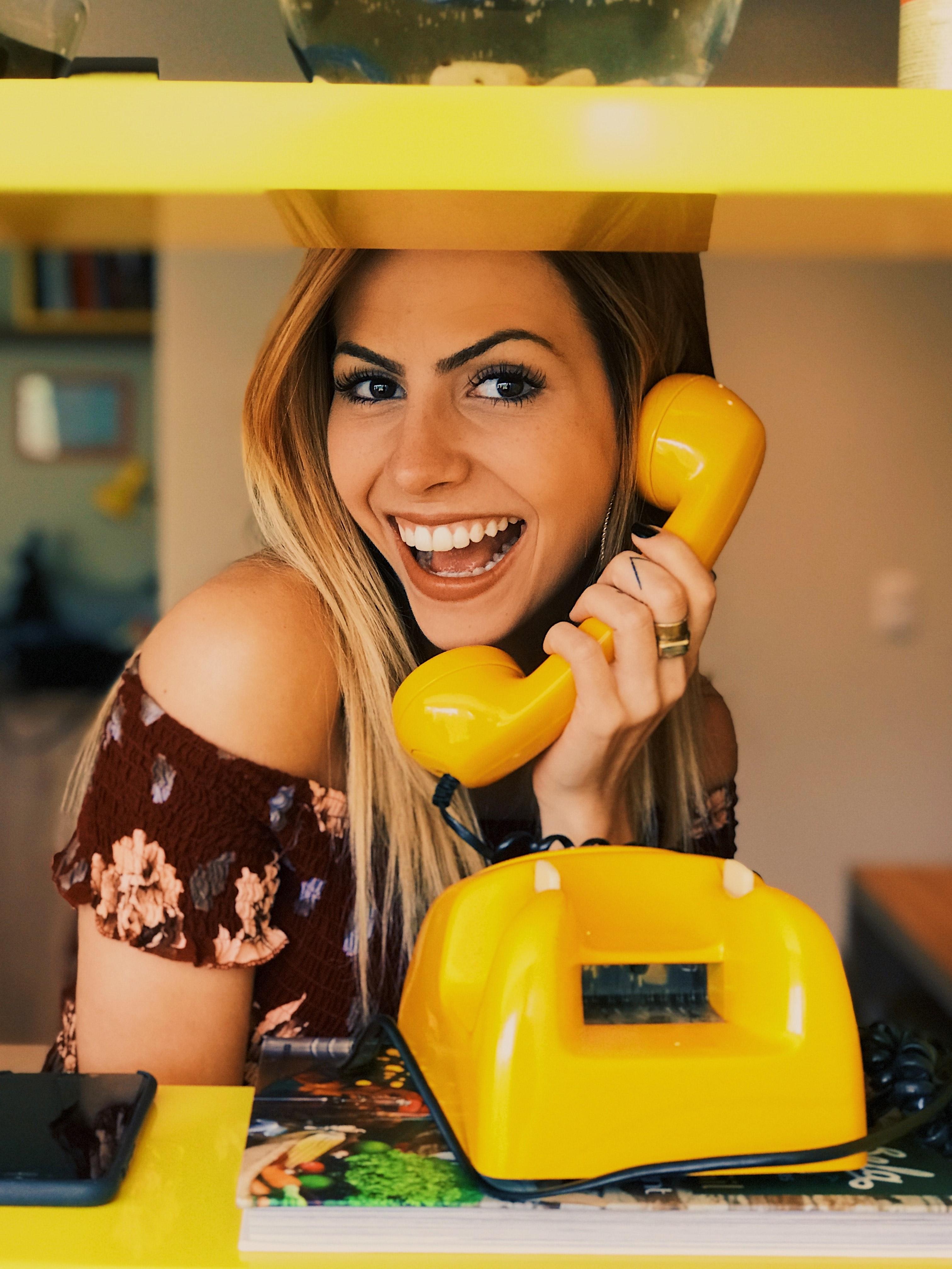 a woman holding a banana