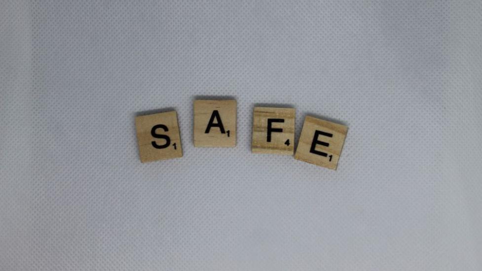 scrabble letters spelling 'safe'