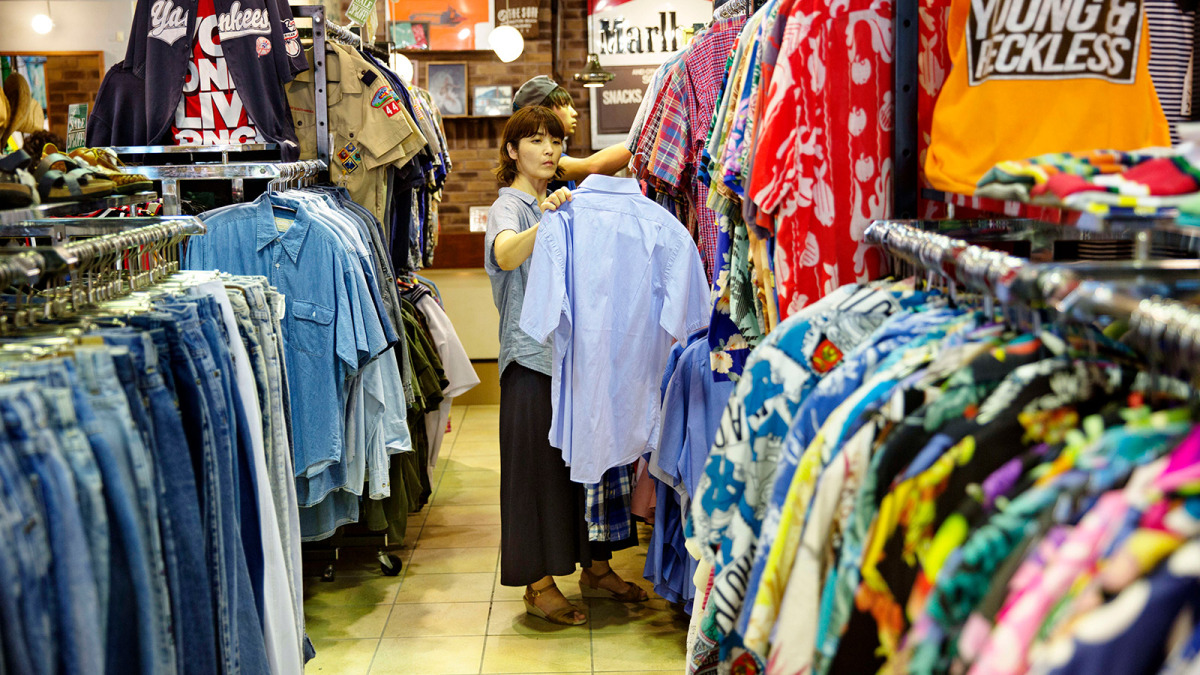 a person standing in front of a store