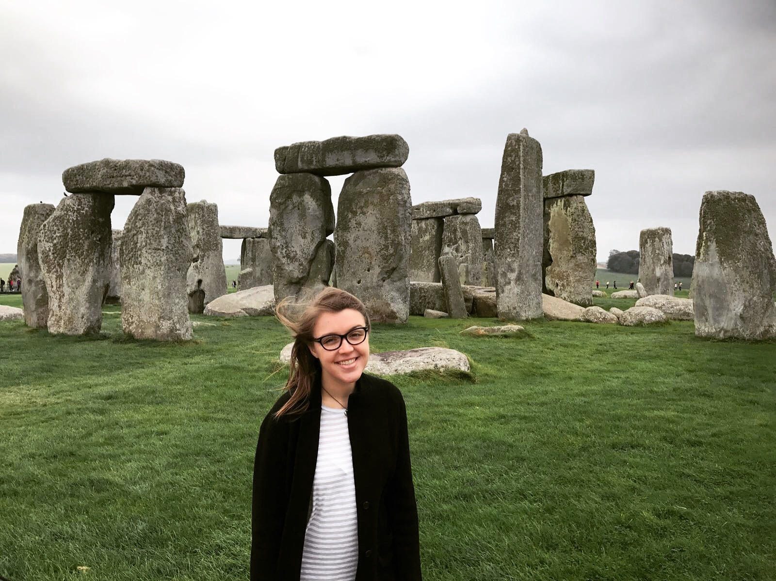 a person standing in front of Stonehenge