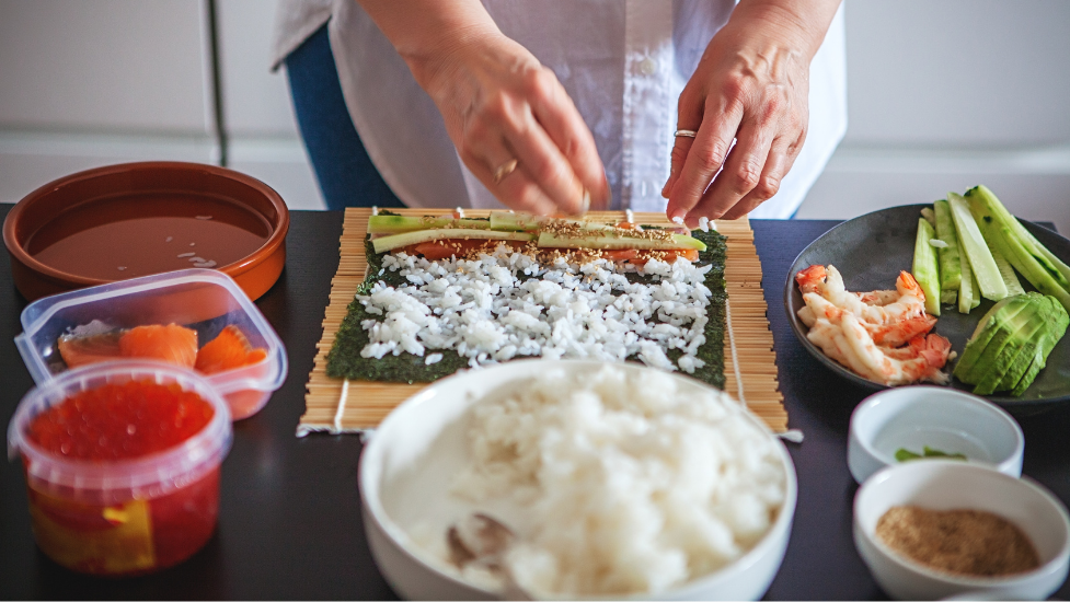a person making sushi