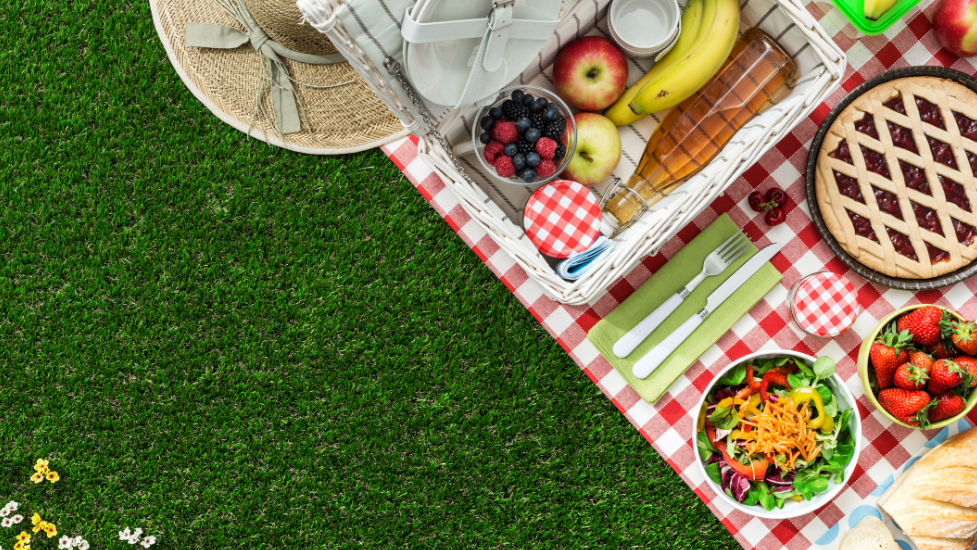 a picnic blanket with different food on it