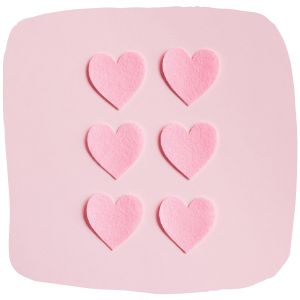 a close up of pink felt hearts
