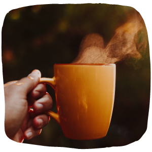 a person holding a mug