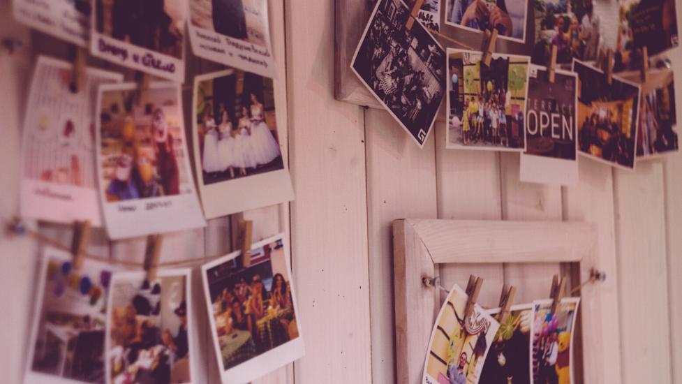 polaroid photos on a wall