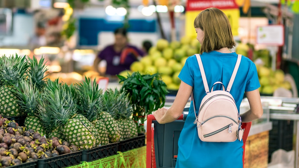 a person standing in front of a produce stand