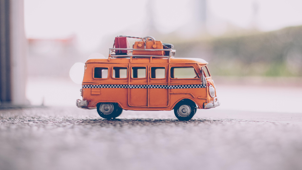 a close up of a toy car with suitcases on the roof