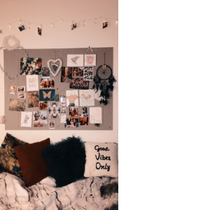 a pinboard above a bed