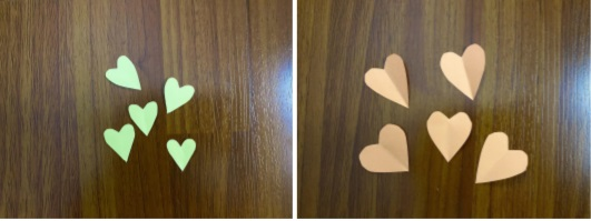 a close up of cut out hearts