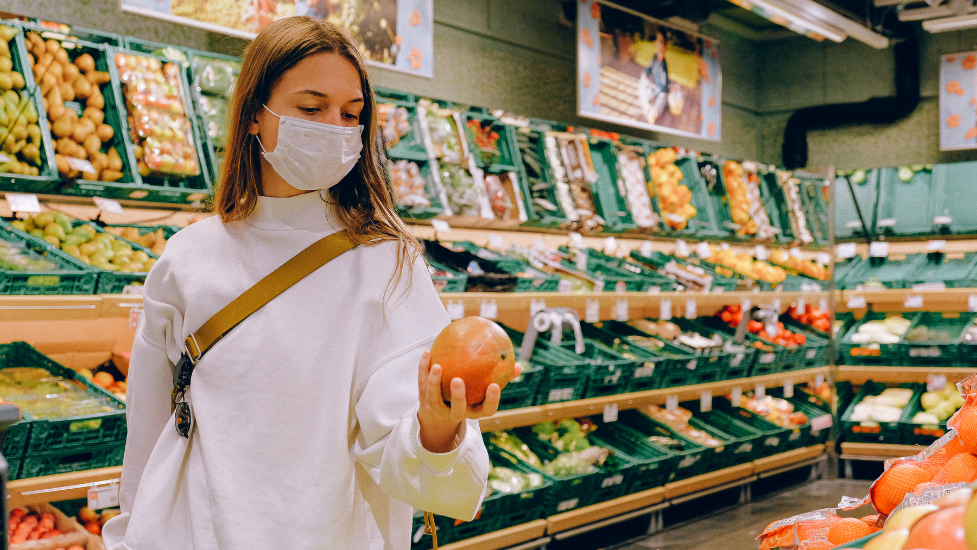 a person wearing a mask in a supermarket