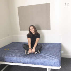 a person sitting on a bed