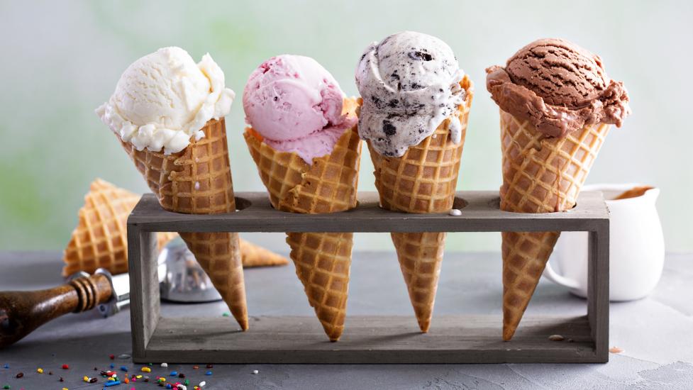 different flavoured ice cream in cones