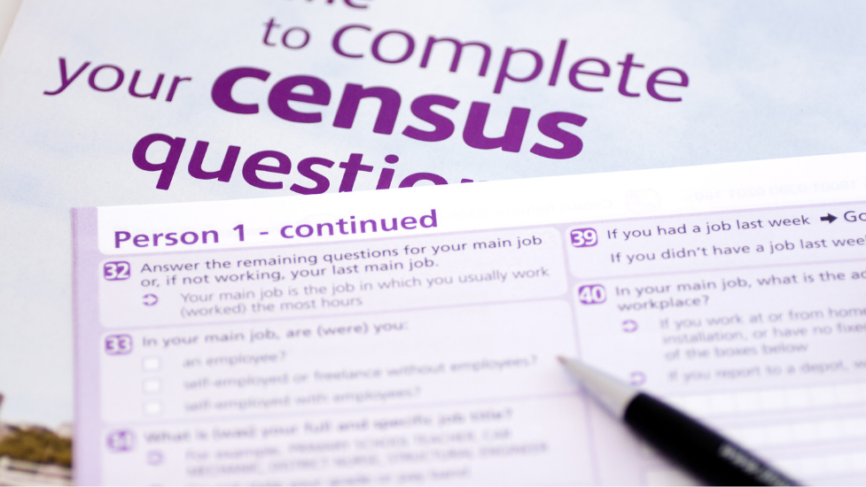 the census form next to a pen