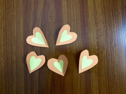 a close up of paper hearts