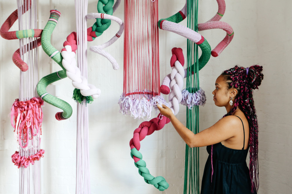 Women with textile installation