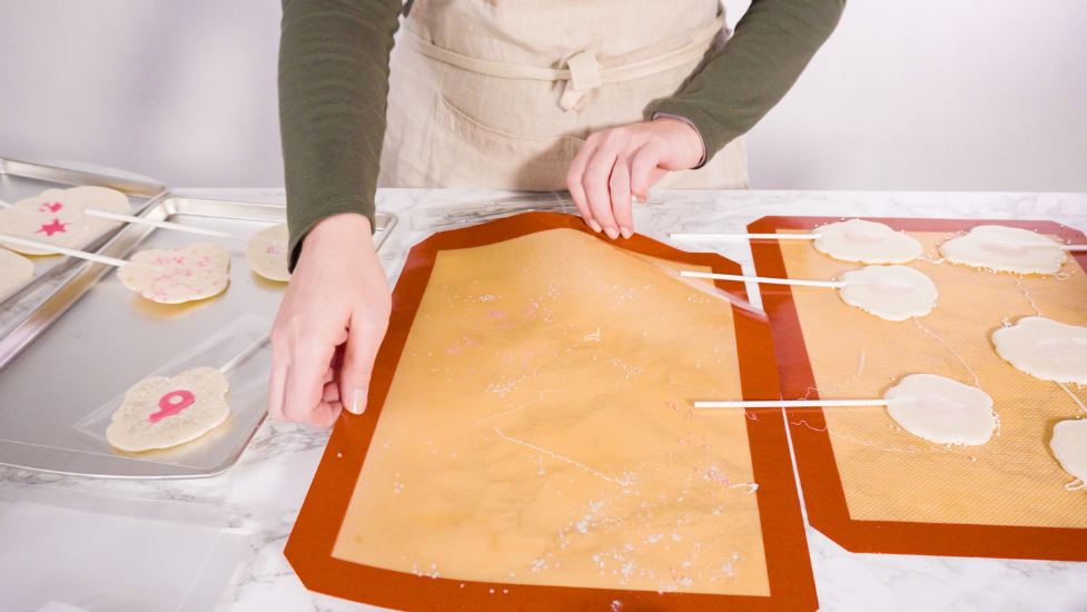 a person using silicone oven mats for baking