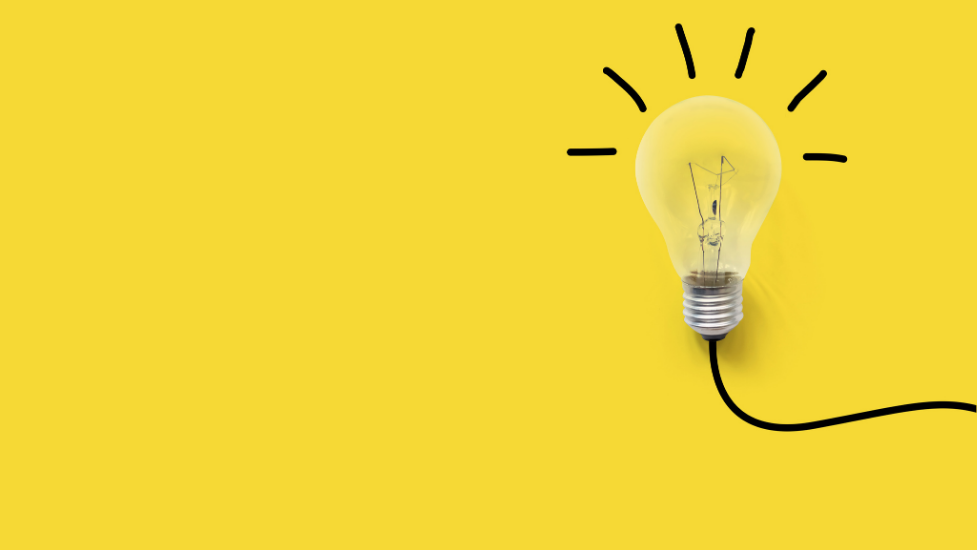 a light bulb on a yellow background