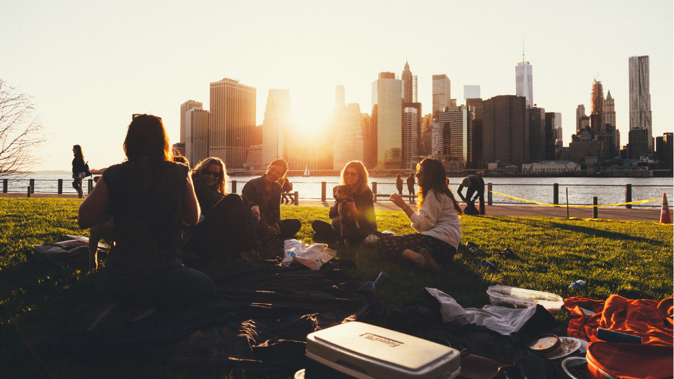 a group of people sitting in a park