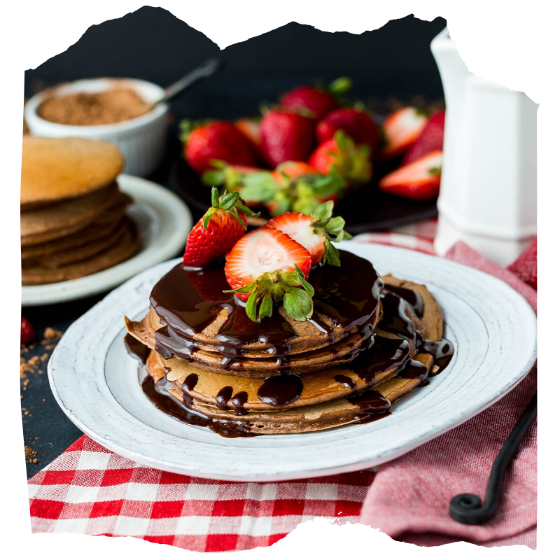 pancakes on a plate covered in chocolate