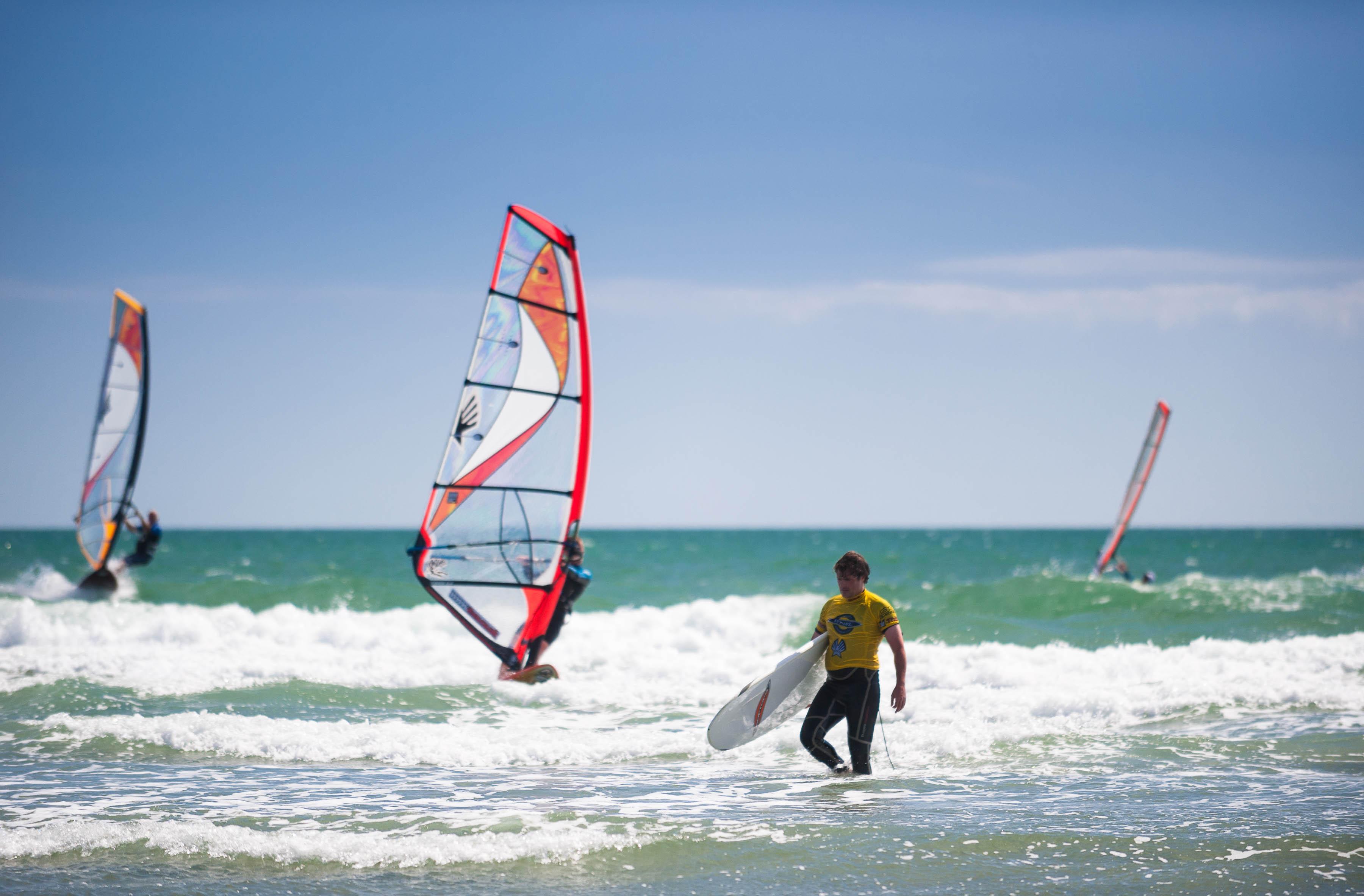 a man kite surfing in the ocean