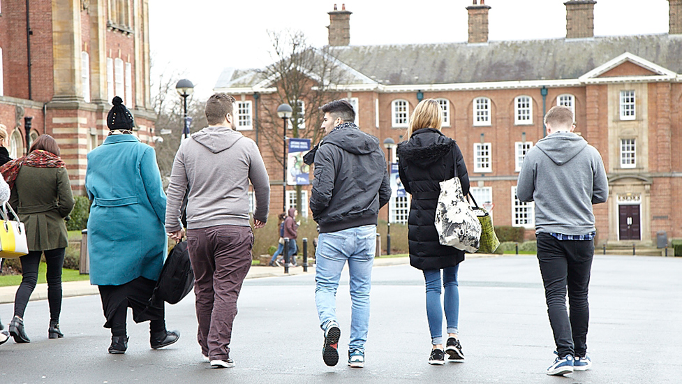 a group of people walking down a street