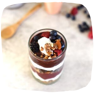 a yoghurt with fruit and sauce on top of it