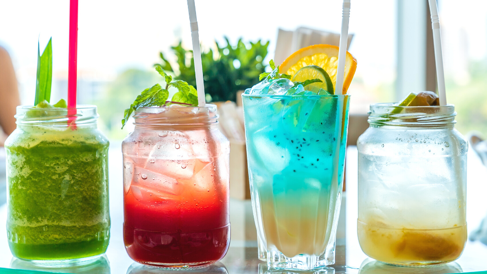 different coloured mocktails on a table