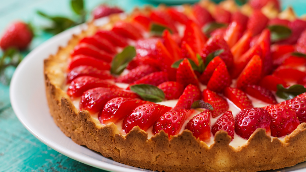 a close up of a strawberry tart
