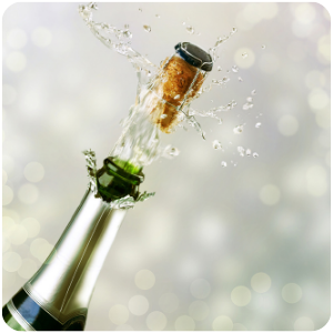 a popping bottle of champagne
