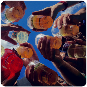 people holding drinks