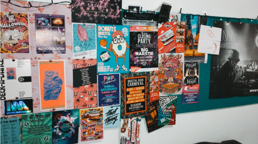 a pin board with posters on it