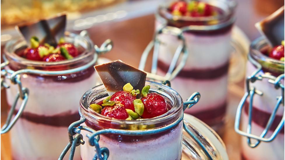 a close up of dessert in a jar