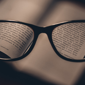 a close up of glasses reading