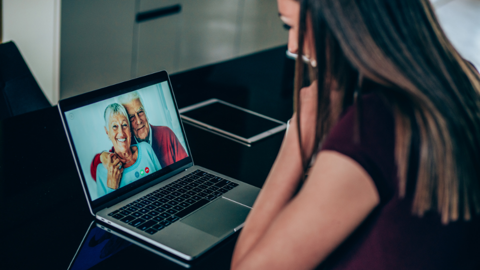 a woman using a laptop computer to facetime