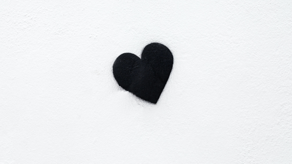 a black heart on a white wall
