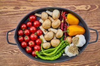 vegetables in a bowl on a wooden table