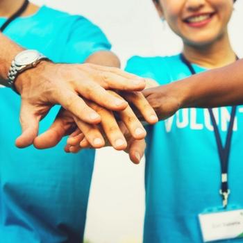 people wearing a volunteering tshirt