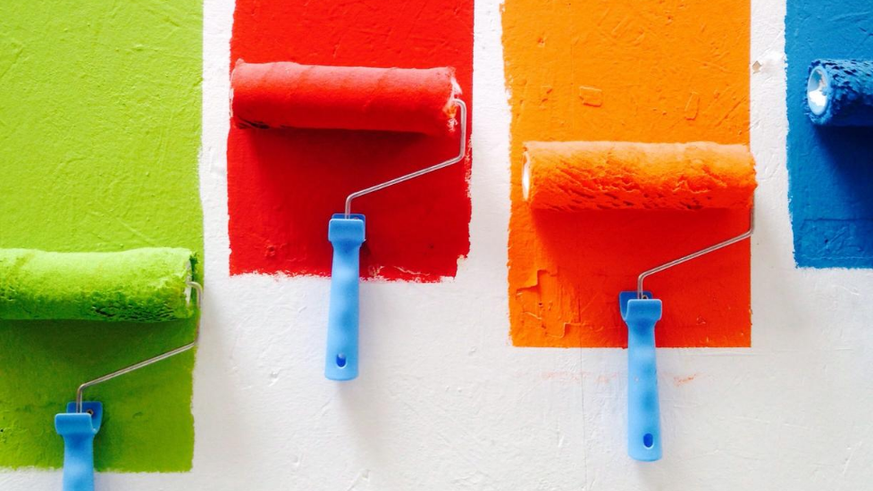 A wall being painted different colours